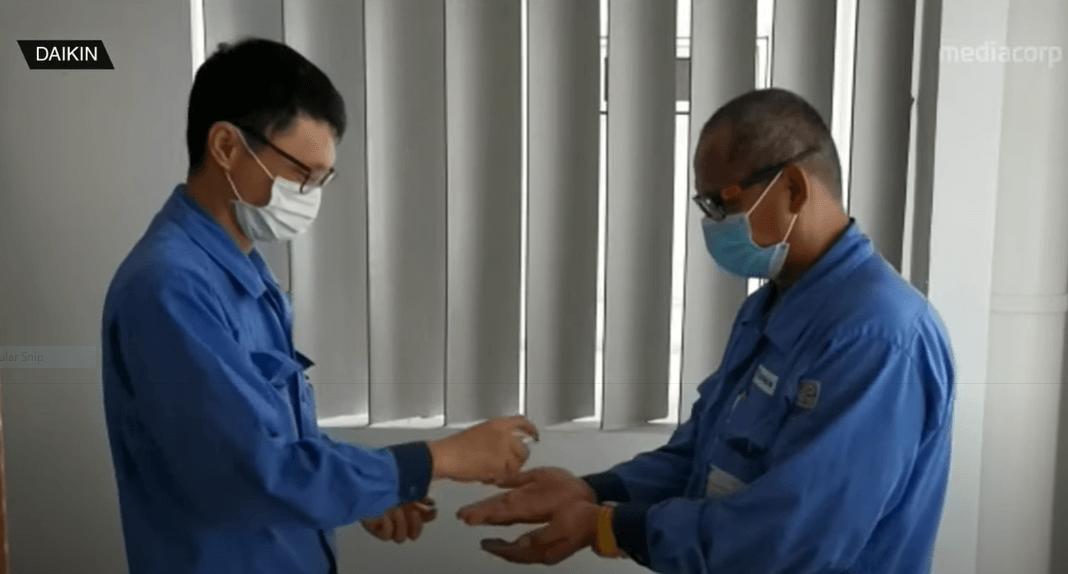 Daikin Service Staff Sanitising Hands